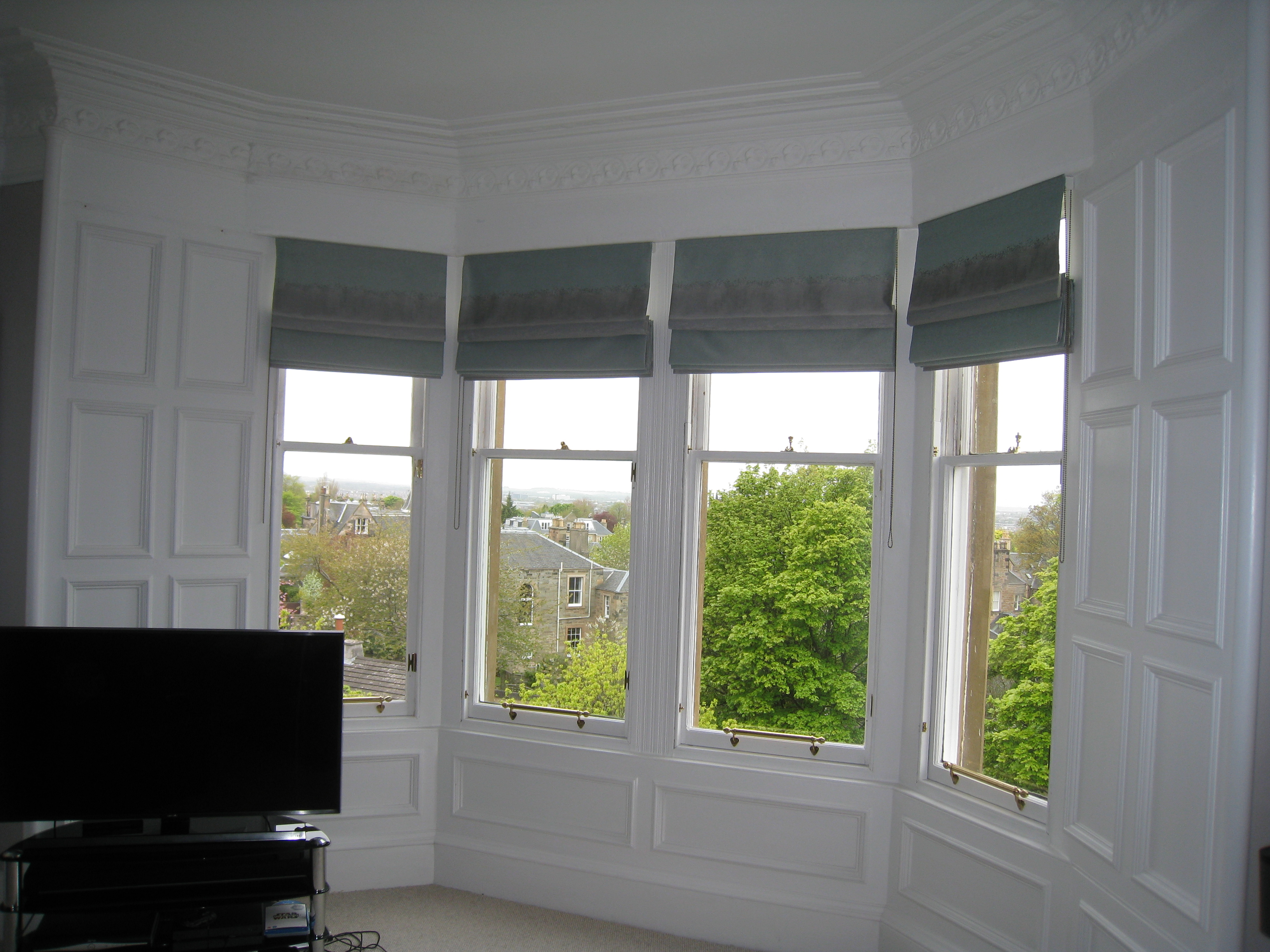 Roman blinds for bay windows ines interiors because it for Roman shades for bay window