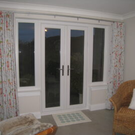 Curtains and blind for open plan kitchen diner