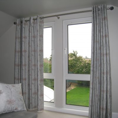 Eyelet curtains with blackout lining on metal pole, Cramond, Edinburgh