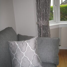 Rails, curtains and matching cushions