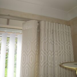 Wave headed curtains on Metropole rail